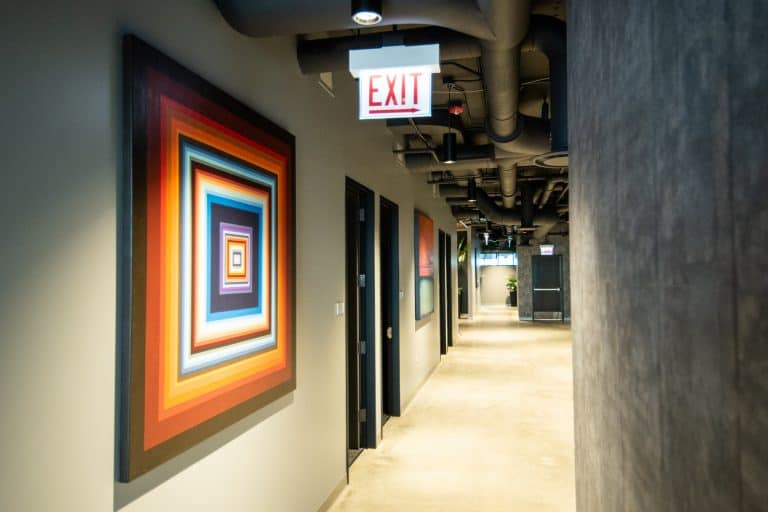 CRC Rehab Center in Chicago's spacious, bright hallway that leads to the different therapy areas featuring beautiful, modern artwork.