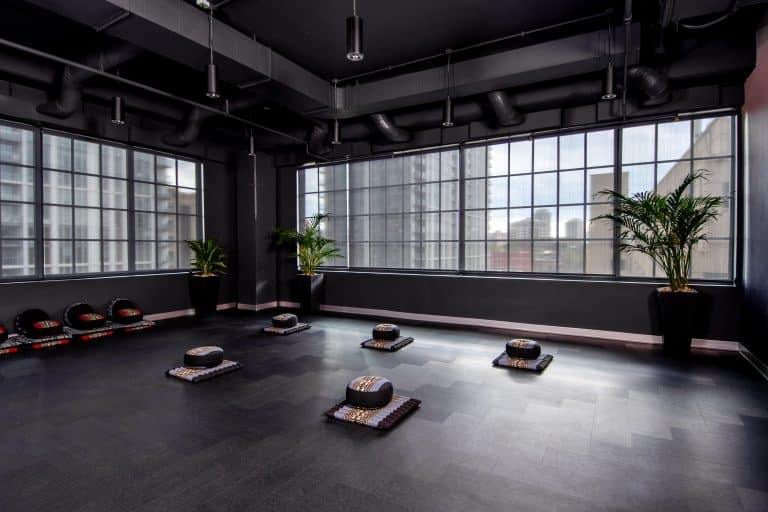 The yoga studio at CRC's rehab center in Chicago in an open, spacious room with big windows and dark ombre wall color.
