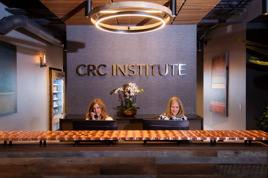 The patient care team at CRC's rehab center in Chicago hard at work in the front desk reception area.