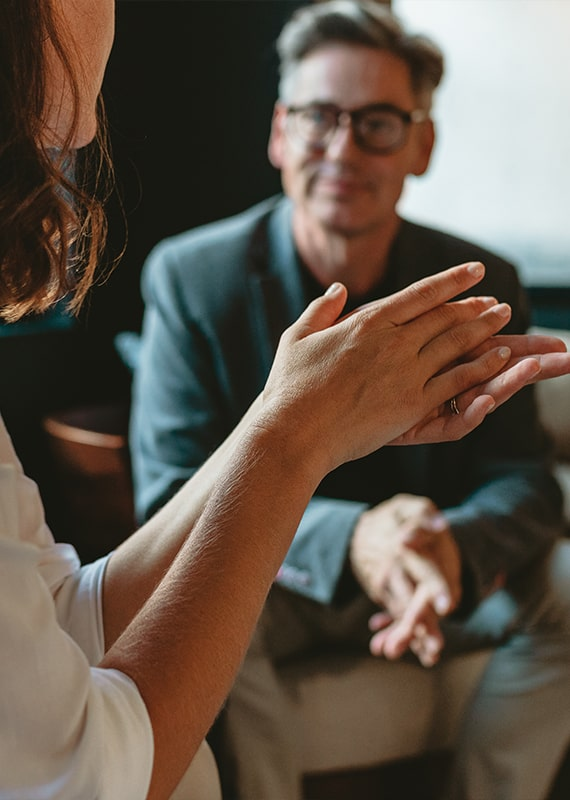 Female clinical therapist treating a male rehab patient while he participates in addiction counseling at CRC's rehab center in Chicago